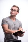 Young man holding a book Royalty Free Stock Photography