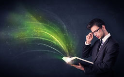 Young man holding book with wave Stock Image