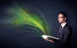 Young man holding book with wave Stock Photos