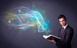 Young man holding book with waves Stock Image