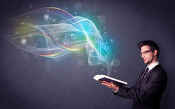 Young man holding book with waves Stock Photo