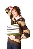 Young man holding books Stock Images