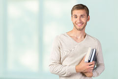 Young man holding books Royalty Free Stock Photography