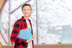 young man holding books Royalty Free Stock Images