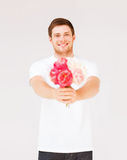 Young man holding bouquet of flowers Stock Photography