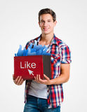 Young man holding a box of likes Royalty Free Stock Image
