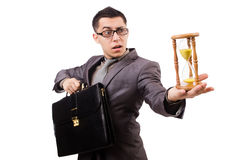 Young man holding briefcase and sandglass isolated Stock Images