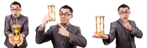 The young man holding briefcase and sandglass isolated on white Stock Image