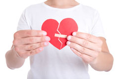 Young man holding broken heart with plaster Stock Image