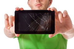 Young man holding broken tablet Stock Photography