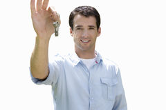 young man holding bunch of keys, cut out Stock Photos