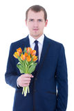 Young man holding bunch of tulips Royalty Free Stock Images