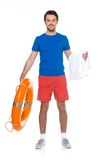 Young man holding buoy ring and smiling. Royalty Free Stock Photos