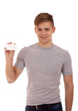 Young man holding businesscard Royalty Free Stock Photo