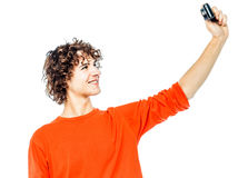 Young man holding camera photographing portrait Stock Photo