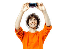 Young man holding camera photographing portrait. One young man caucasian holding camera photographing portrait  in studio white background Royalty Free Stock Photos