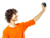 Young man holding camera photographing portrait Stock Images