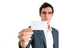 Young man holding card Royalty Free Stock Photos