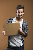Young man holding a card board Stock Photography