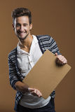 Young man holding a card board Stock Photos