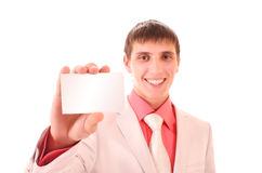 Young man holding a card isolated Royalty Free Stock Image