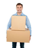 Young man holding cardboard boxes Royalty Free Stock Photography