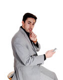 Young man holding cell phone. Stock Image
