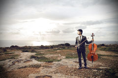 Young man holding a cello Stock Photos