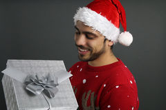 Young man holding a Christmas present Stock Photography