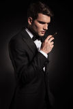Young man holding a cigarette in his hand. Royalty Free Stock Photo