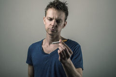 Young man holding a cigarette Stock Photo