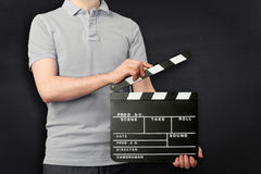Young man holding clapper board Stock Image