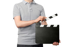 Young man holding clapper board. Young man holding blank clapper board isolated on white background Royalty Free Stock Image