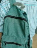Young Man Holding A Classic Green Fabric Backpack Royalty Free Stock Photography
