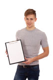 Young man holding clip board Stock Image