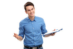 Young man holding clipboard Royalty Free Stock Photos