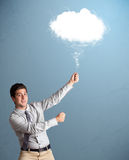 Young man holding cloud Stock Photo