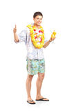 Young man holding a cocktail Royalty Free Stock Images