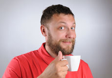 Young man holding a coffee cup Stock Photography