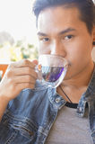 Young man holding coffee cup or hot tea Stock Photo
