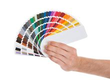 Young man holding color palette Stock Photography