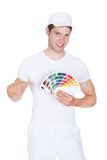 Young man holding color palette Royalty Free Stock Photography