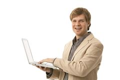 Young man holding computer Royalty Free Stock Photos