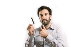 Young man holding a credit card thumbs up Royalty Free Stock Images