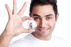 Young Man Holding Crystal Ball Royalty Free Stock Image
