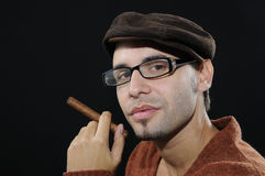 Young man holding cuban cigar Stock Photography