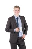 Young man is holding a cup of coffee Royalty Free Stock Photography
