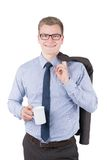 Young man is holding a cup of coffee Royalty Free Stock Photos