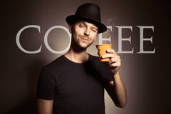 Young man holding cup of coffee Stock Photo
