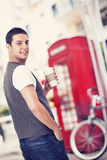 Young man holding a cup of coffee Stock Photography